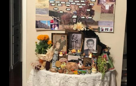 Decorating the ofrenda with my family for Dia de Los Muertos. (Photo Courtesy of Adalie Landa)