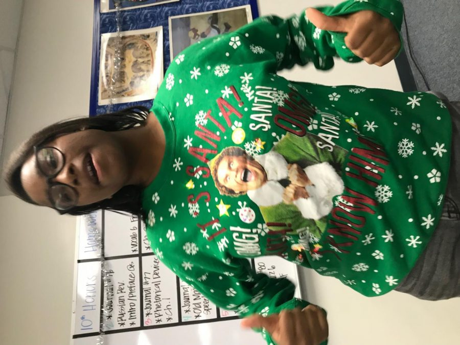 Genique+shows+off+her+Christmas+spirit+with+her+%22Elf%22+themed+sweater.%0A%0APhoto+Courtesy+of+Megan+Jun