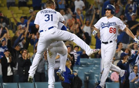 LOS ANGELES, CA - JUNE 13:  Joc Pederson #31 and Ross Stripling #68 celebrate with Enrique Hernandez #14 of the Los Angeles Dodgers as they defeated the Texas Rangers in the eleventh inning at Dodger Stadium on June 13, 2018 in Los Angeles, California.  (Photo by Jayne Kamin-Oncea/Getty Images)