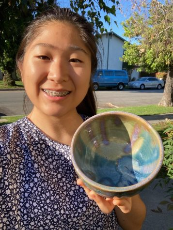 Cassia Park shares a photo of her and one of her pieces from ceramics.